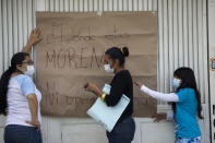 """<p>Neighbors hang a sign that reads in Spanish: """"Where is Morena?"""" referring to a political party in charge of the local government in San Gregorio Atlapulco, Mexico, Friday, Sept. 22, 2017, three days after an earthquake. Mexican officials are promising to keep up the search for survivors as rescue operations stretch into a fourth day following Tuesday's major earthquake that devastated Mexico City and nearby states. (AP Photo/Moises Castillo) </p>"""