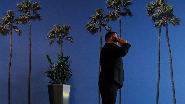 PHOTO: A man talks on the phone at a hotel near the Los Angeles International Airport in Los Angeles, May 4, 2018. (Jae C. Hong/AP, FILE)