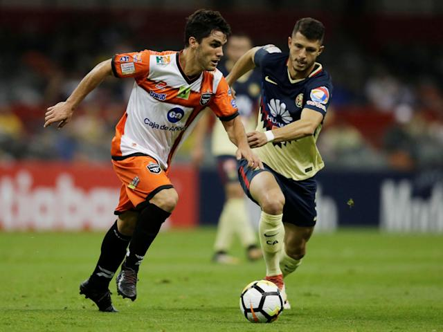Soccer Football - Club America v Tauro FC- CONCACAF Champions League - Azteca stadium, Mexico City, Mexico - March 6, 2018 - Jose Tamburelli of Tauro FC and Guido Rodriguez of Club America in action. REUTERS/Henry Romero