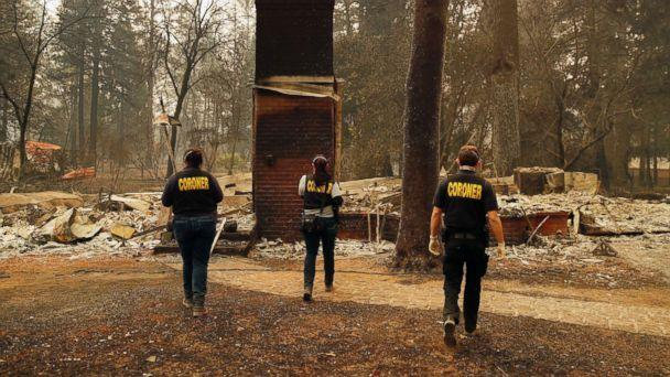 PHOTO: Members of the Sacramento County Coroner's office look for human remains in the rubble of a house burned at the Camp Fire, Nov. 12, 2018, in Paradise, Calif. (John Locher / AP)