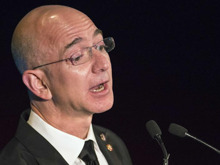 Amazon CEO and Chairman Jeff Bezos receives the Citation of Merit on behalf of the Apollo F-1 Search and Recovery Team at the 110th Explorers Club Annual Dinner at the Waldorf Astoria in New York March 15, 2014.