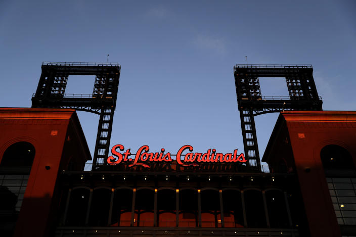 Absent from the game for more than two weeks because of a COVID-19 outbreak, the St. Louis Cardinals will now race to play 53 games in 45 days. (AP Photo/Jeff Roberson)
