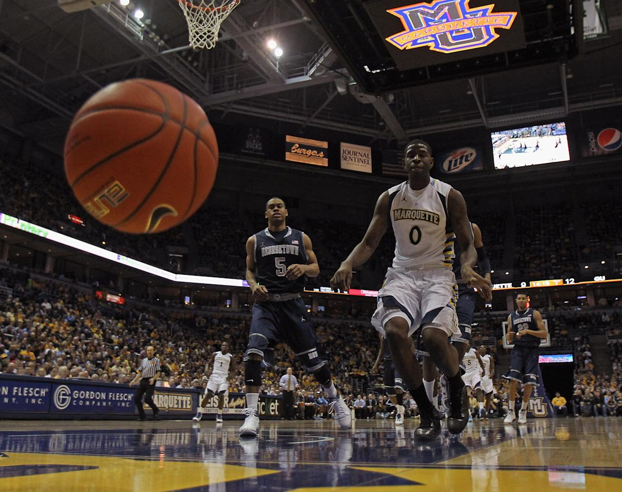 MILWAUKEE, WI - MARCH 03: Jamil Wilson #0 of the Marquette Golden Eagles and Markel Starks #5 of the Georgetown Hoyas try to chase down a loose ball at the Bradley Center on March 3, 2012 in Milwaukee, Wisconsin. (Photo by Jonathan Daniel/Getty Images)