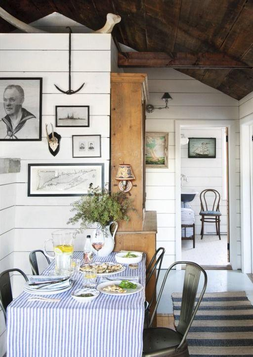 """<p>A small bistro table set in a hallway creates a mini makeshift dining room. Bright white shiplap painted with a coat of <a href=""""https://www.benjaminmoore.com/en-us/color-overview/find-your-color/color/cc-30/oxford-white?color=CC-30"""" rel=""""nofollow noopener"""" target=""""_blank"""" data-ylk=""""slk:Oxford White by Benjamin Moore"""" class=""""link rapid-noclick-resp"""">Oxford White by Benjamin Moore</a> makes the ceilings of these tiny quarters soar.</p>"""