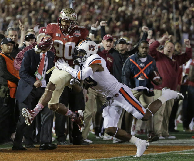 Florida State's Rashad Greene (80) makes a catch against Auburn's Ryan White (19) during the first half of the NCAA BCS National Championship college football game Monday, Jan. 6, 2014, in Pasadena, Calif. (AP Photo/Chris Carlson)