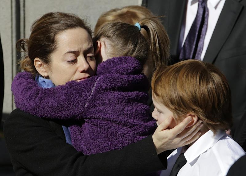 Mimi O'Donnell, estranged partner of actor Philip Seymour Hoffman, comforts two of their children, daughter Willa, and son Cooper as his casket arrives at the Church of St. Ignatius Loyola, Friday, Feb. 7, 2014 in New York. Hoffman, 46, was found dead Sunday of an apparent heroin overdose. (AP Photo/Mark Lennihan)