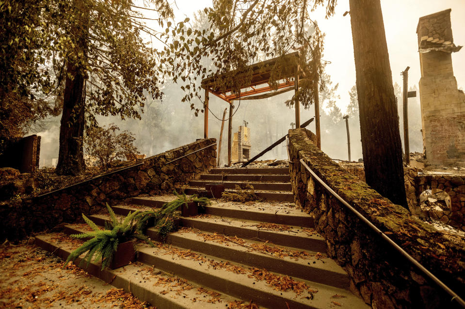 FILE - In this Sept. 28, 2020, file photo, a staircase remains at the Restaurant at Meadowood, which burned in the Glass Fire, in St. Helena, Calif. In three of the past four years, major wildfires driven by a changing climate have devastated parts of the world-class region, leaving little doubt that it's vulnerable to smoke, flames and blackouts during the fall. (AP Photo/Noah Berger, File
