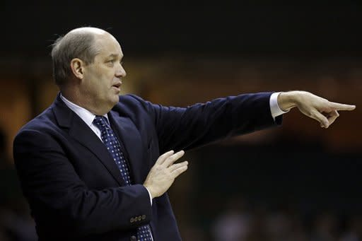 Vanderbilt head coach Kevin Stallings directs his players in the first half of an NCAA college basketball game against Texas A&M on Saturday, Feb. 16, 2013, in Nashville, Tenn. (AP Photo/Mark Humphrey)