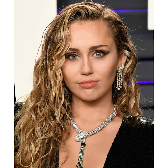 """<p>Miley Cyrus's signature dark blonde hue looks a lot like what <a href=""""https://www.instagram.com/whiteroombrooklyn/?hl=en"""" rel=""""nofollow noopener"""" target=""""_blank"""" data-ylk=""""slk:Whiteroom"""" class=""""link rapid-noclick-resp"""">Whiteroom</a> salon co-founder and stylist Elisabeth Lovell calls """"<a href=""""https://www.allure.com/story/dark-blonde-hair-colors?mbid=synd_yahoo_rss"""" rel=""""nofollow noopener"""" target=""""_blank"""" data-ylk=""""slk:fall cooldown hair"""" class=""""link rapid-noclick-resp"""">fall cooldown hair</a>."""" It's a nice rescue option for a warm blonde base that's turned brassy in the sun. </p> <p>If you fall into that category, ask your colorist to blend your roots with an ashy, light brown and then weave in skinny ribbons of a very light pearl shade throughout. When you hit the salon, """"ask for a golden blonde hue with bright highlights to pop around the face,"""" says Jung of this """"naturally sun-kissed surfer vibe.""""</p>"""