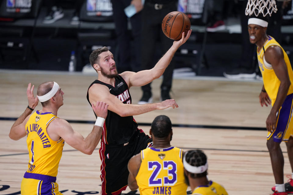 Miami Heat's Goran Dragic (7) drives to the basket against the Los Angeles Lakers during the first half of Game 1 of basketball's NBA Finals Wednesday, Sept. 30, 2020, in Lake Buena Vista, Fla. (AP Photo/Mark J. Terrill)