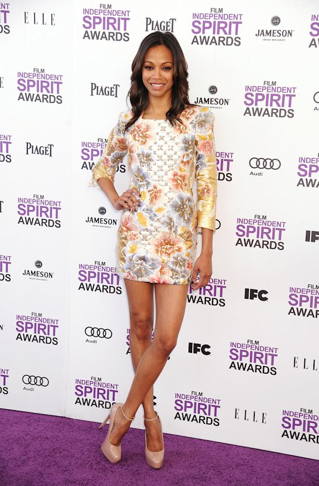 """""""Avatar"""" alum Zoe Saldana nearly took our breath away (as she always does) in a stunning Balmain mini and nude-hued Brian Atwood pumps."""