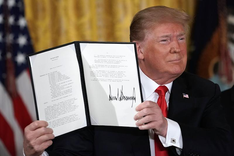 WASHINGTON, DC - JUNE 18: U.S. President Donald Trump holds up an executive order that he signed during a meeting of the National Space Council at the East Room of the White House June 18, 2018 in Washington, DC. President Trump signed an executive order to establish the Space Force, an independent and co-equal military branch, as the sixth branch of the U.S. armed forces. (Photo by Alex Wong/Getty Images)