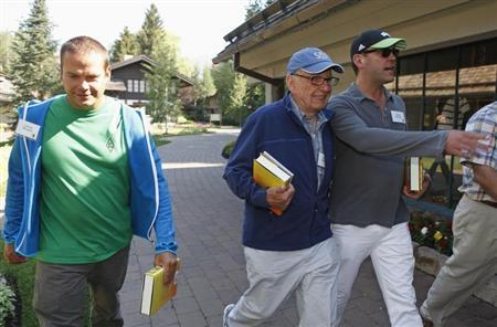 News Corp Chief Executive and Chairman Rupert Murdoch (C) and sons Lachlan Murdoch (L) and James Murdoch attend the Allen & Co Media Conference in Sun Valley, Idaho July 12, 2012. REUTERS/Jim Urquhart