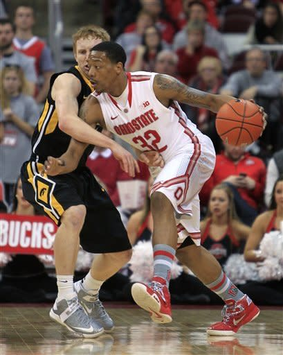 Ohio State's Lenzelle Smith, right, works against Iowa's Mike Gesell during the first half of an NCAA college basketball game Tuesday, Jan. 22, 2013, in Columbus, Ohio. (AP Photo/Jay LaPrete)
