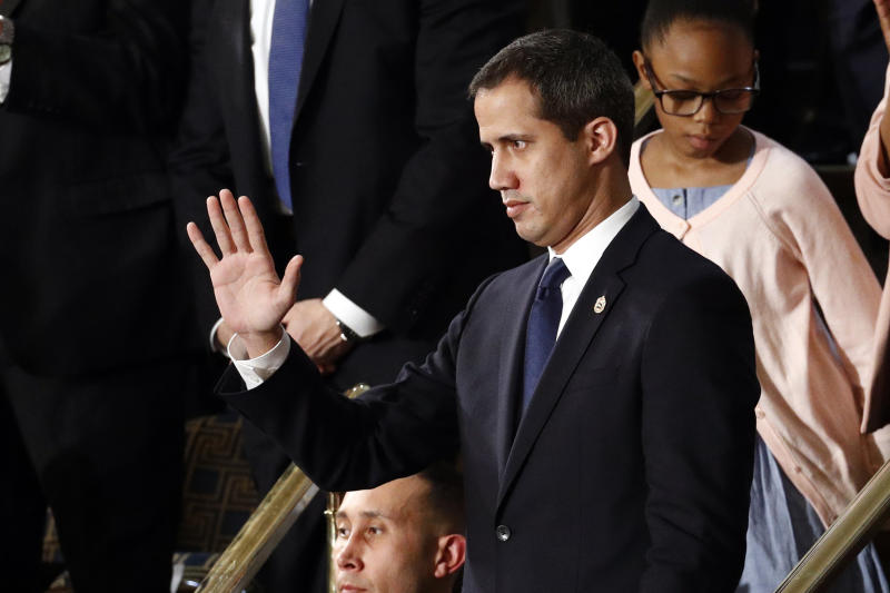 Venezuelan opposition leader Juan Guaido waves as President Donald Trump delivers his State of the Union address to a joint session of Congress on Capitol Hill in Washington, Tuesday, Feb. 4, 2020. (AP Photo/Patrick Semansky)