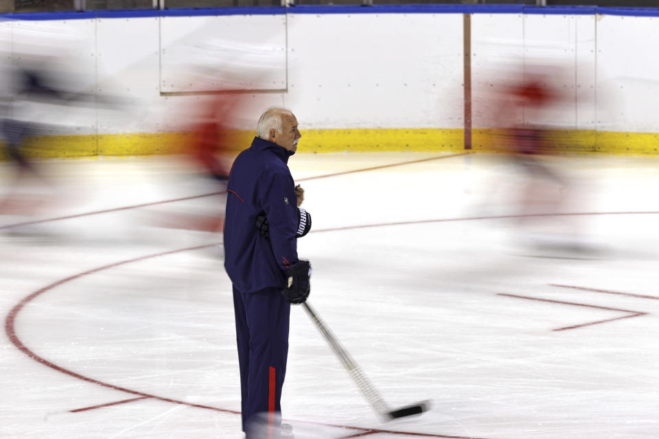 Florida Panthers head coach Joel Quenneville looks on as his player skate during training camp in preparation for the 2021-22 NHL season at the FLA Live Arena on Thursday, September 23, 2021 in Sunrise, Florida.(David Santiago/Miami Herald via AP)