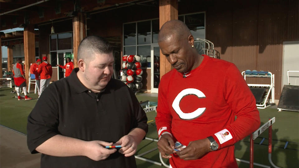 Eric Davis opening 25-year-old baseball cards with Yahoo Sports. (AP)