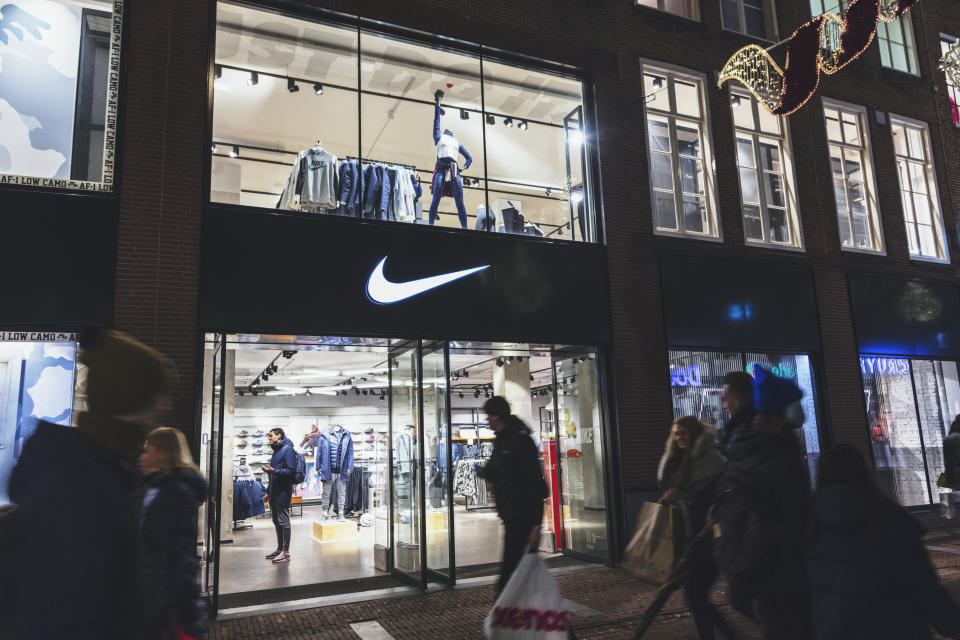 Amsterdam, Netherlands - December 15, 2017: People walks by Nike sports fashion store in Amsterdam, Netherlands. Nike brand was valued at 19 billion USD in 2014.