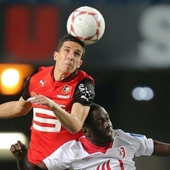French midfielder Vincent Pajot, up, jumps for a header with Lille's midfielder Idrissa Gueye during their french League One soccer match in Rennes, western France, Friday, Sept. 28, 2012. (AP Photo/David Vincent)
