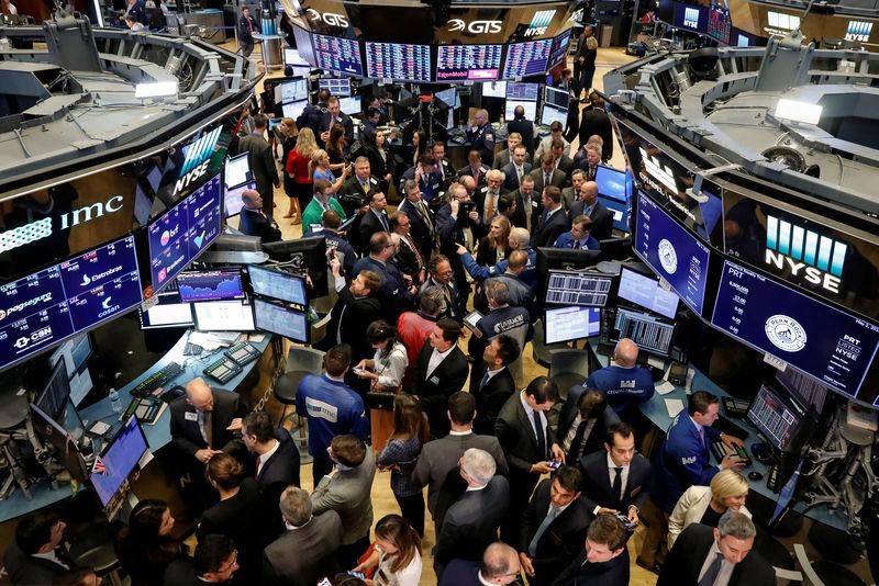 FILE PHOTO: Traders and guests gather for the IPO of PermRock Royalty Trust on the floor of the NYSE in New York