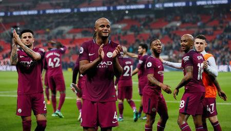 Soccer Football - Premier League - Tottenham Hotspur vs Manchester City - Wembley Stadium, London, Britain - April 14, 2018 Manchester City's Vincent Kompany and teammates applaud the fans after the match REUTERS/David Klein