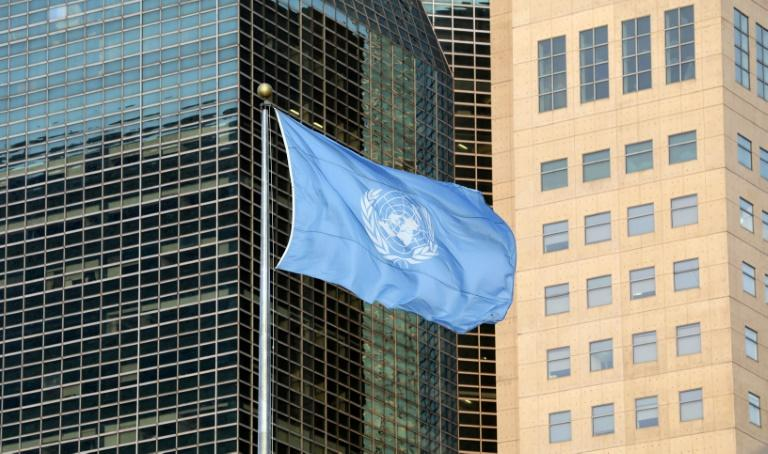 The flag of the UN outside the New York headquarters of the world body, seen in a photo taken on September 23, 2019 (AFP Photo/Ludovic MARIN)
