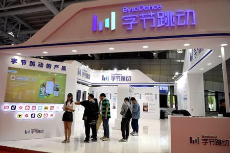 FILE PHOTO: People are seen at the Bytedance Technology booth at the Digital China exhibition in Fuzhou, Fujian