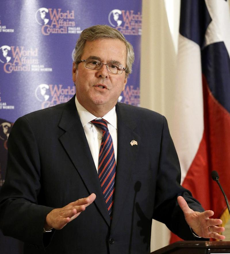 Former Governor Jeb Bush gestures as he speaks during a Dallas Council of World Affairs luncheon Wednesday, April 24, 2013, in Dallas.  Bush and Hillary Rodham Clinton are hitting the speakers' circuit on the eve of the opening of George W. Bush's new presidential library, stoking speculation about their own political futures. (AP Photo/Tony Gutierrez)