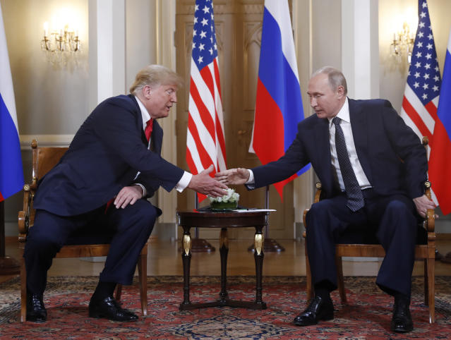 <p>U.S. President Donald Trump, left, and Russian President Vladimir Putin shake hand at the beginning of a meeting at the Presidential Palace in Helsinki, Finland, July 16, 2018. (Photo: Pablo Martinez Monsivais/AP) </p>