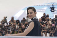 Marion Cotillard poses for photographers at the photo call for the film Annette at the 74th international film festival, Cannes, southern France, Tuesday, July 6, 2021. (AP Photo/Brynn Anderson)