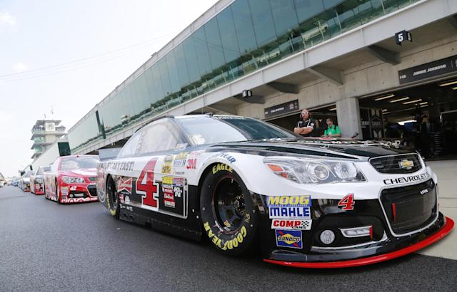 Driver Kevin Harvick sits at the front of a line of cars before the start of practice for the Brickyard 400 Sprint Cup series auto race at the Indianapolis Motor Speedway in Indianapolis, Saturday, July 26, 2014. (AP Photo/R Brent Smith)