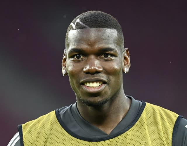 Paul Pogba is all smiles during a training session in Cologne