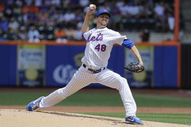 New York Mets' Jacob deGrom delivers a pitch during the first inning of a baseball game against the Washington Nationals, Sunday, Aug. 11, 2019, in New York. (AP Photo/Frank Franklin II)
