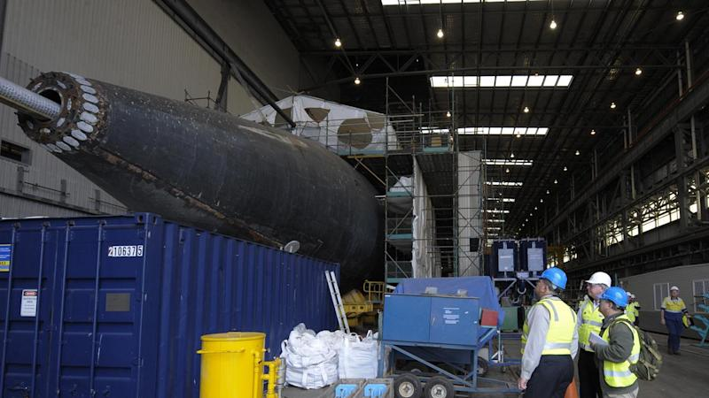 Defence analysis reportedly shows that building subs in Australia would cost more than buying them.