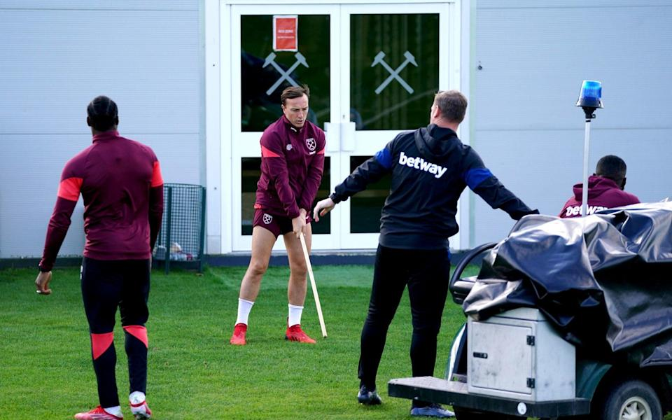 West Ham United's Mark Noble (centre) during a training session at Rush Green, London - PA