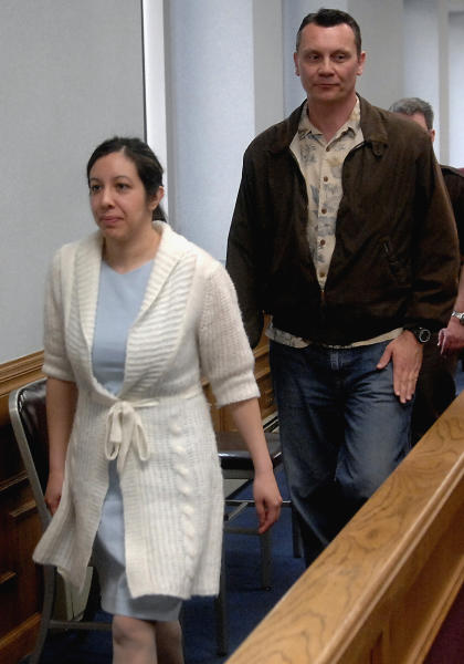 FILE - In this May 7, 2008 file photo, Leilani and Dale Neumann leave a Marathon County Circuit Courtroom in Wausau, Wis. On Wednesday, July 3, 2013, the Wisconsin Supreme Court ruled that the mother and father who prayed instead of seeking medical help as their 11-year-old daughter Madeline Kara Neumann died in front of them were properly convicted of homicide. Their daughter died of undiagnosed diabetes on Easter Sunday in March 2008 at her parents' Weston, Wis., home. (AP Photo/Wausau Daily Herald, Rob Orcutt, File)
