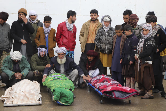 Afghans attend funeral of the family members of journalist Bismillah Adil Aimaq, who was shot dead in an unclaimed attack nearby Ghor on Jan. 1, in in Ghor, western Afghanistan, Friday, Feb. 26, 2021. Gunmen stormed the family home late Thursday and killed three and wounded at least five more of the family. (AP Photo)