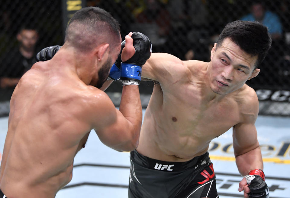 LAS VEGAS, NEVADA - JUNE 19: (R-L) 'The Korean Zombie' Chan Sung Jung of South Korea punches Dan Ige in a featherweight bout during the UFC Fight Night event at UFC APEX on June 19, 2021 in Las Vegas, Nevada. (Photo by Chris Unger/Zuffa LLC)