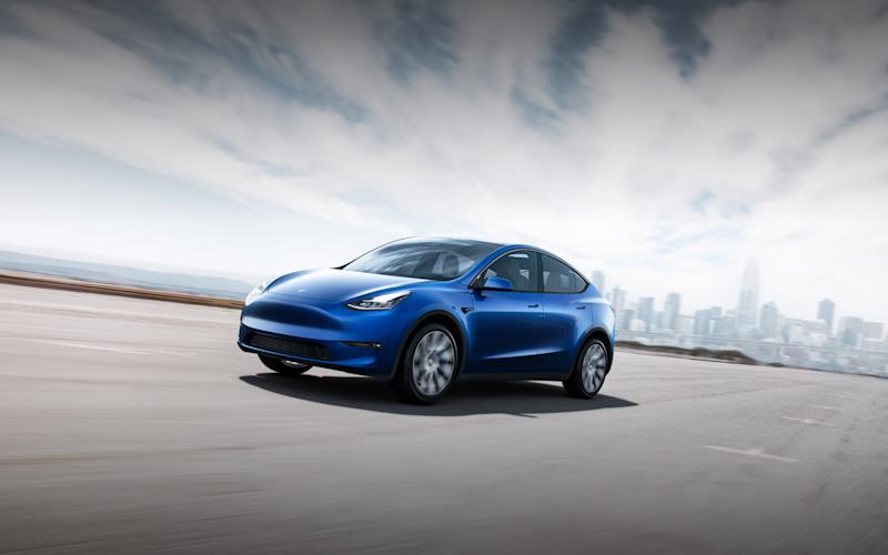 A blue Tesla Model Y car.