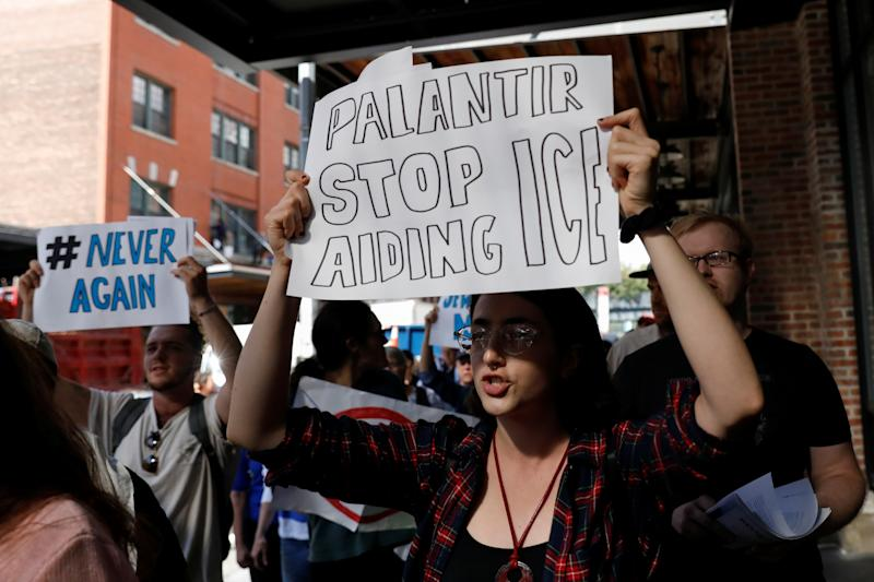 Activists protest outside the Palantir Technologies software company for allegedly helping ICE and the Trump administration in New York City, U.S., September 13, 2019. REUTERS/Shannon Stapleton