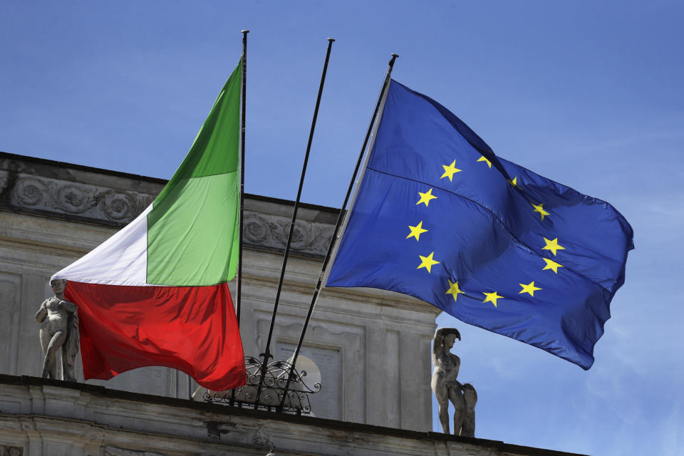 The Italian and the EU flags are displayed outside Villa Pamphili as Italian Premier Mario Draghi and EU Commission President Ursula von Der Leyen arrive on the occasion of the Global Health Summit in Rome, Friday, May 21, 2021. (AP Photo/Gregorio Borgia)