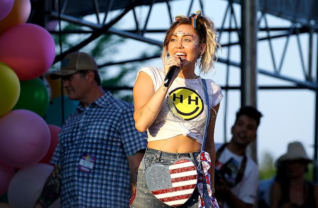 """<p>Cyrus brought her Happy Hippie Foundation to Washington, D.C., for the 2017 Capital Pride Concert. She wore a rainbow painted on her forehead and some funky, <a href=""""https://www.yahoo.com/celebrity/celebrities-celebrate-pride-2017-160015967.html"""" data-ylk=""""slk:bedazzled jeans"""" class=""""link rapid-noclick-resp"""">bedazzled jeans</a> for her performance. (Photo: John Lamparski/WireImage) </p>"""