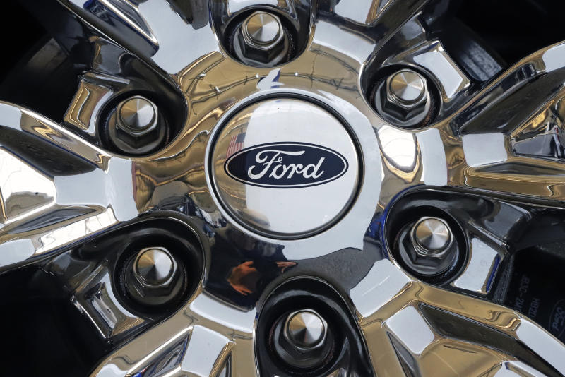 FILE- In this Feb. 14, 2019, file photo a wheel on a 2019 Ford Expedition 4x4 is displayed at the 2019 Pittsburgh International Auto Show in Pittsburgh. Ford Motor Co. said Tuesday, March 19, it will shift 550 jobs to its Kentucky Truck Plant to boost production of its Expedition and Lincoln Navigator to meet growing demand for its large SUVs. (AP Photo/Gene J. Puskar, File)
