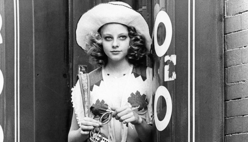 Jodie Foster stands and waits in a scene from the film 'Taxi Driver', 1976. (Photo by Columbia Pictures/Getty Images)