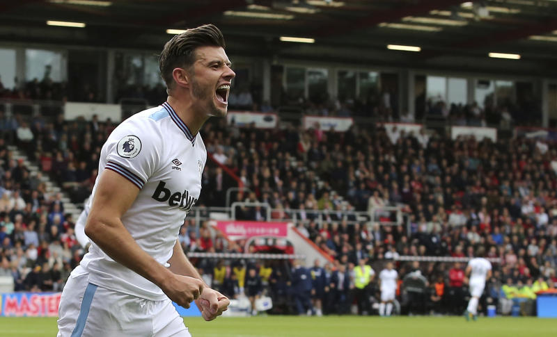 West Ham United's Aaron Cresswell celebrates scoring his side's second goal of the game against Bournemouth during their English Premier League soccer match at the Vitality Stadium in Bournemouth, England, Saturday, Sept. 28, 2019. (Mark Kerton/PA via AP)