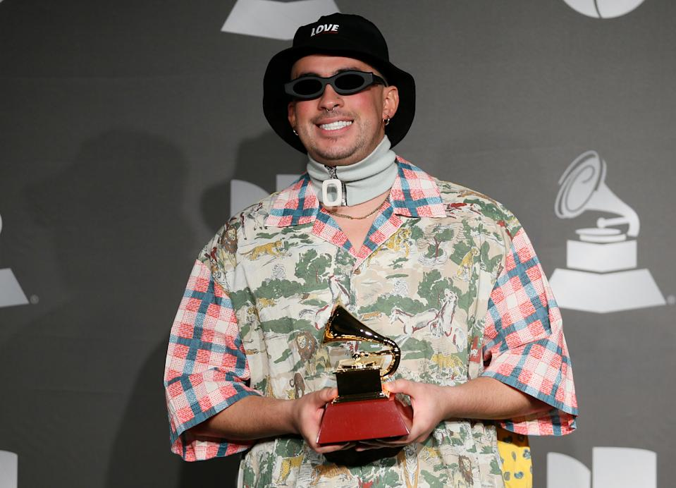 """The 20th Annual Latin Grammy Awards – Photo Room– Las Vegas, Nevada, U.S., November 14, 2019 – Bad Bunny poses backstage with his Best Urban Music Album award for """"X 100pre""""."""