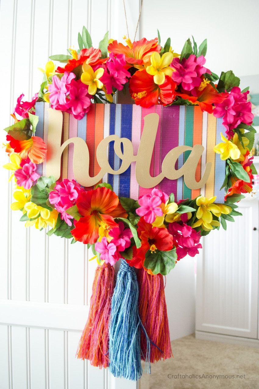 "<p>Before you slide on those flip flops and pour that glass of lemonade, say a proper ""hola"" to summer with this brightly colored silk floral wreath.</p><p><strong>Get the tutorial at <a href=""https://www.craftaholicsanonymous.net/summer-fiesta-wreath"" rel=""nofollow noopener"" target=""_blank"" data-ylk=""slk:Craftaholics Anonymous"" class=""link rapid-noclick-resp"">Craftaholics Anonymous</a>.</strong></p><p><a class=""link rapid-noclick-resp"" href=""https://www.amazon.com/Best-Sellers-Arts-Crafts-Sewing-Craft-Glue-Guns/zgbs/arts-crafts/12898851?tag=syn-yahoo-20&ascsubtag=%5Bartid%7C10050.g.4395%5Bsrc%7Cyahoo-us"" rel=""nofollow noopener"" target=""_blank"" data-ylk=""slk:SHOP HOT GLUE GUNS"">SHOP HOT GLUE GUNS</a><br></p>"