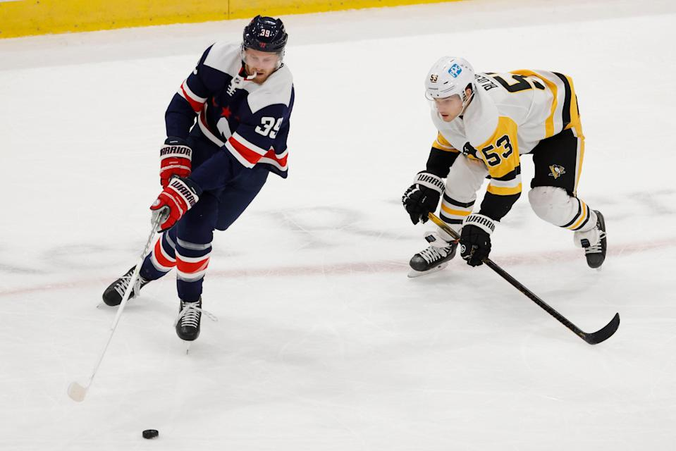 Washington Capitals right wing Anthony Mantha skates with the puck as Pittsburgh Penguins center Teddy Blueger defends May 1, 2021.