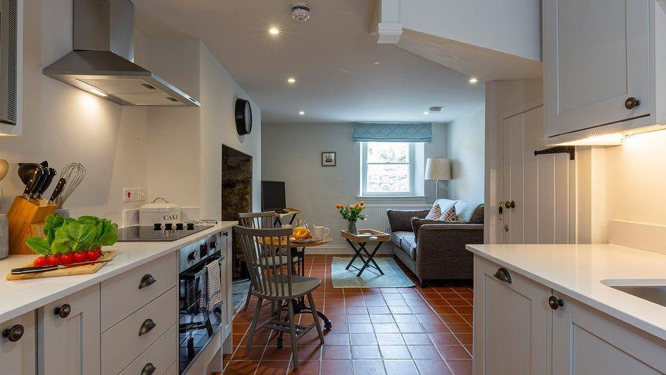 "<p>This dog-friendly Christmas cottage is a Victorian farmhouse annexe with bags of charm. It's located on the Ceredigion coastline in West Wales, 400 metres up from one of the area's best kept secrets – Penbryn beach. There is a woodburner in the open plan living room and kitchen downstairs, while upstairs you'll find the bedroom and ensuite bathroom, making Penbryn perfect for couples.</p><p><strong>Be sure to... </strong>Go exploring the quiet coves, tramping over rocky cliffs, meandering along beaches and simply taking in mesmerising turquoise waters where you can often spot bottlenose dolphins. </p><p><strong>Sleeps: </strong>2</p><p><strong>Pets: </strong>Yes</p><p><strong>Price: </strong>£999 for 7 nights over Christmas and New Year (short breaks can be booked one month before for peak periods)</p><p><a class=""link rapid-noclick-resp"" href=""https://go.redirectingat.com?id=127X1599956&url=https%3A%2F%2Fwww.nationaltrust.org.uk%2Fholidays%2Fpenbryn-cottage-wales&sref=https%3A%2F%2Fwww.countryliving.com%2Fuk%2Ftravel-ideas%2Fstaycation-uk%2Fg33888029%2Fchristmas-cottage%2F"" rel=""nofollow noopener"" target=""_blank"" data-ylk=""slk:FIND OUT MORE"">FIND OUT MORE </a></p><p><strong><a href=""https://hearst.emsecure.net/optiext/optiextension.dll?ID=lq4lgpcAuz%2BVDWaZO1C4jPxg7227ab9YExHA_BSg4Uw5ngmqTMwLkiiEbS%2BxaUlbUhEHIuPv9v6XlA"" rel=""nofollow noopener"" target=""_blank"" data-ylk=""slk:Sign up"" class=""link rapid-noclick-resp"">Sign up</a> for inspirational travel stories and to hear about our favourite financially protected escapes and bucket list adventures.</strong></p><p><a class=""link rapid-noclick-resp"" href=""https://hearst.emsecure.net/optiext/optiextension.dll?ID=lq4lgpcAuz%2BVDWaZO1C4jPxg7227ab9YExHA_BSg4Uw5ngmqTMwLkiiEbS%2BxaUlbUhEHIuPv9v6XlA"" rel=""nofollow noopener"" target=""_blank"" data-ylk=""slk:SIGN UP"">SIGN UP</a></p>"