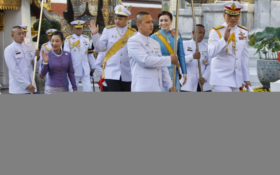 King Maha Vajiralongkorn, pictured greeting supporters on Wednesday, holds great constitutional power in Thailand - EPA